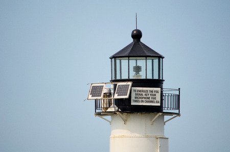 a sign on a light house in St Joseph michigan alerts boaters using solar power photo