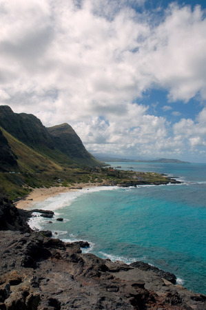 kona: Coast line in Kona hawaii    dramatic beaches of volcanic beach and white sand beach with dramatic clouds and crystal blue waters Stock Photo
