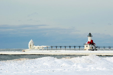 The water, the wind, and the cold winter weather has created beautiful icy structures to view on the shores of Lake Michigan in St Joe  here, on North Pier, mother nature has created an ultimate ice sculpture  版權商用圖片