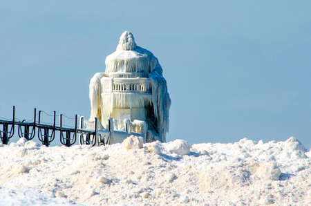 The light house in St Joseph Michigan becomes a natural sculpture of ice with help by mother nature photo