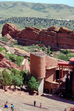 Red Rocks Amphitheatre, Morrison Colorado: people walk along the natural amphitheater called Red Rocks.. This beautiful venue is a natural concert hall carved out of sandstone