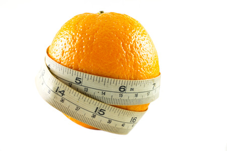 naranja fruta: frutas de color naranja y cinta m�trica
