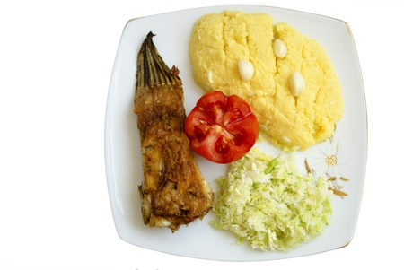 sapid: fish, hominy, tomato and cabbage salad on a plate