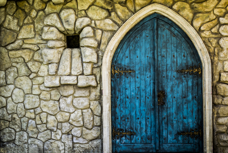 Blue wooden kids castle door in a park Banque d'images
