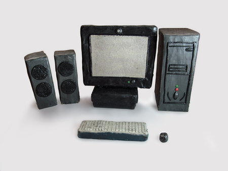 Desktop computer made from plasticine on a white background. Plasticine monitor, speakers, system unit, keyboard, mouse Stock Photo