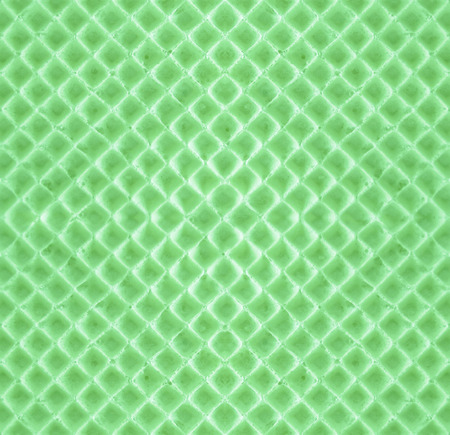 Green seamless backdrop - texture  waffle. Delicate sweet delicious wafer pattern for pastry-making