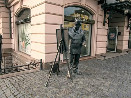 Ukraine, Uzhhorod - April 30,2018: Statue of painter Ignac Roskovics on embankment of Independence in Uzhgorod. The bronze artist, standing at the easel, paints the landscape, sculptor Mikhail Kolodko Editöryel