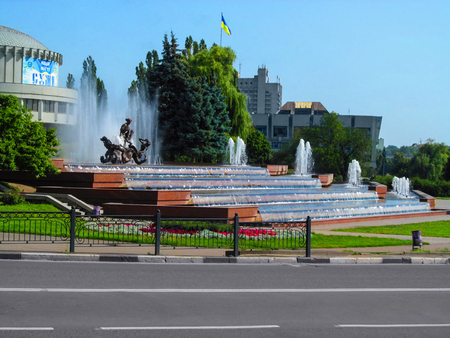 Ukraine, Sumy - July 25, 2014: Fountain of Sadko on a bright summer day in Sumy. Sadko Fountain - this is one of the main sights of the city of the Soviet era, beautiful city landscape on a sunny day