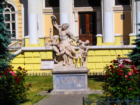 Ukraine, Odessa - June 08, 2015: Copy of the sculptural group Laocoön and His Sons in front of the Odessa Archaeological Museum. The statue made of the Carrara marble and figures have their hands Editöryel