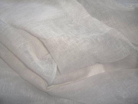 White mesh textile pattern. Medical gauze close-up, empty cotton fabric for mockup Фото со стока