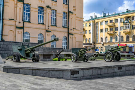Kharkiv, Ukraine - July 20, 2020: Three cannons and howitzers from the World War II are on the street near the Historical Museum in Kharkov. Exhibition of military equipment outdoors