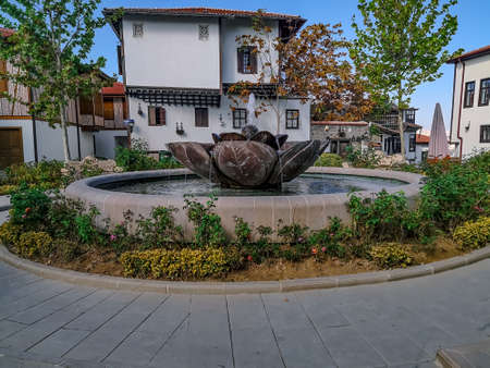 Turkey, Ankara - October 23, 2019: Beautiful autumn landscape with a fountain in the Ankara fortress. Ancient architecture of a residential area inside an ancient castle
