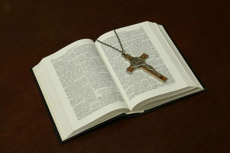 dogma: open bible and crucifix