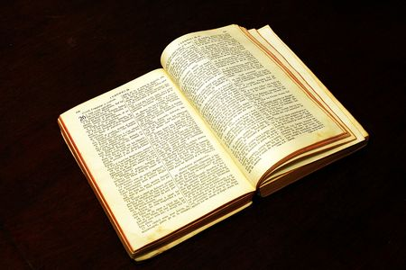 exorcism: bible on a dark brown table
