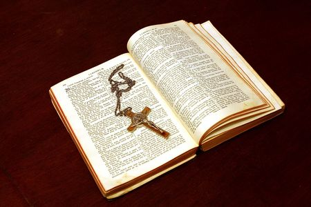 dogma: bible and crucifix on a brown table Stock Photo