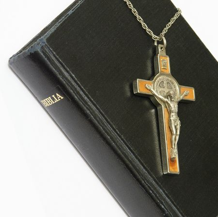dogma: bible and crucifix on white background