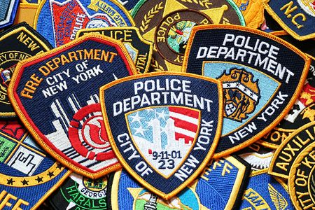sacrifices: police and firefighters patches Stock Photo