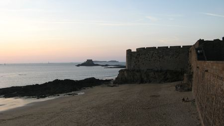 fortification: fortification and water at sunset, saint-malo, france