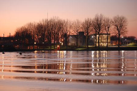 water reflexions and waves at sunset, Citadelle Park, Lille, France photo