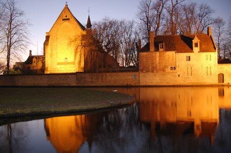 old buildings reflexions, brugge, belgium photo