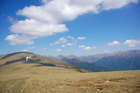 smoke-like cloud above mountain peack, fagaras mountains, the carpathians photo