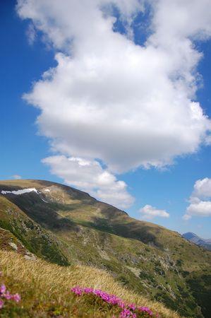 beautiful sky over a peack in fagaras mountains, the carpathians photo