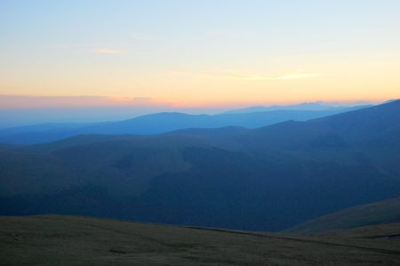 trecking: soft colors of sunset in the mountains Stock Photo