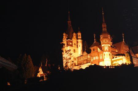 magic landscape with peles castle museum, sinai, romania photo