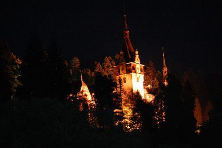 peles castle museum by night, sinaia, romania photo