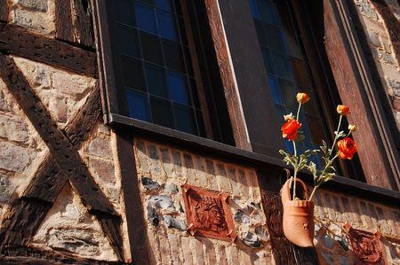 shoe decoratin on ancient house, beauvais, france photo