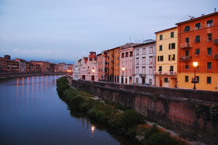 river side: buildings and church on the river side, pisa, italy