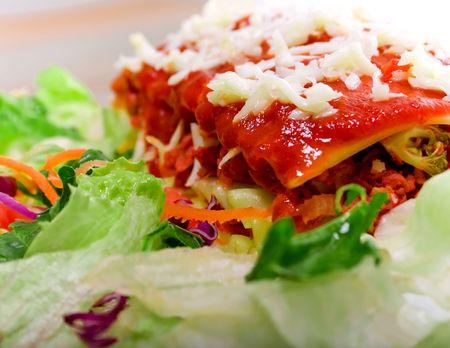 Close up of Lasagana with salad - vivid colors photo