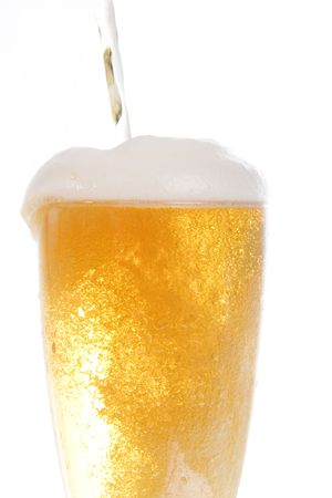 barley head: Beer being poored onto tall glass over white background