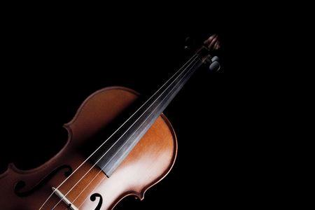 medium shot: Medium shot of violin over dark background