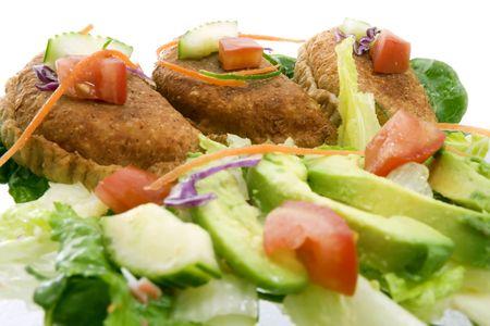 High key closeup shot of Mexican empanadas with traditional salad - selective focus on center empanada photo