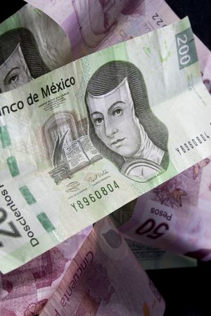 Close up shot of mexican currency over black background