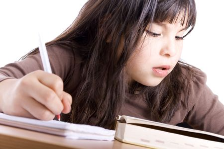 Young Girl doing homework - Isolated on white photo
