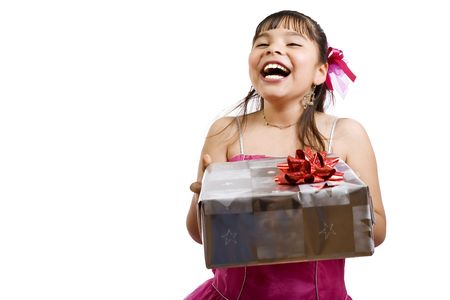 endearing: Studio shot of endearing girl with gift wearing fancy dress - focus on gift Stock Photo