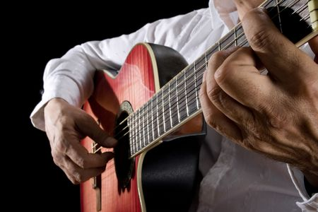jazz: Close up of man playing classical guitar