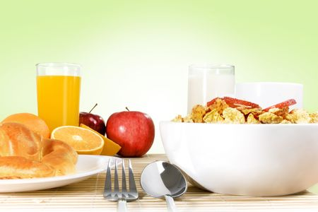 Light breakfast setting over bamboo placemat, green gradient background photo
