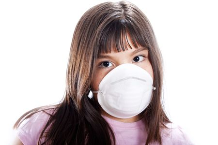 epidemic: Studio shot of young girl wearing protective mask, isolated on white Stock Photo