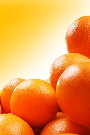Studio shot of group of oranges over gradient yellow background Stock Photo