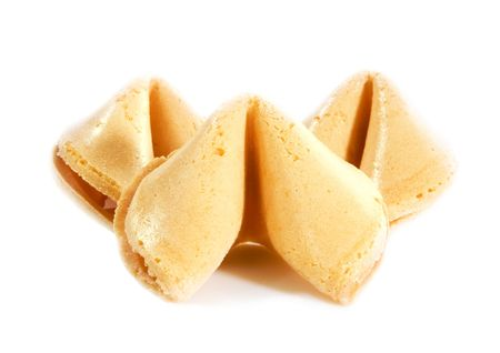 Shot of three fortune cookies over white background photo