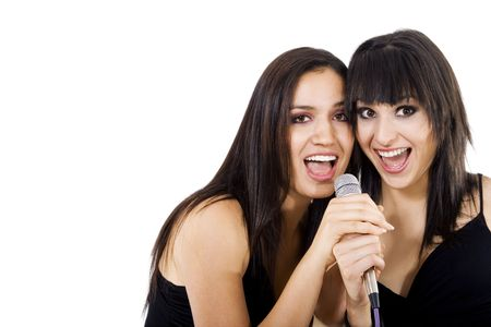Stock photo of two girls singing, isolated on white with copy space photo