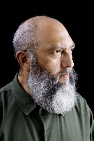 Portrait of male soldier with long beard over black background