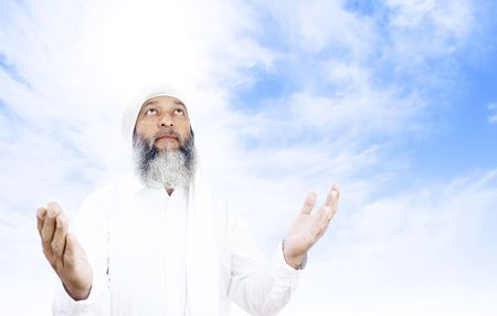 middle eastern clothing: Stock image of Arabic man praying over open sky background