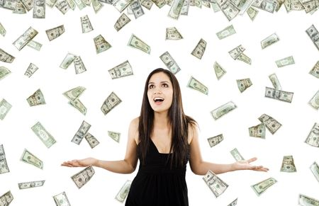 woman flying: Stock image of woman standing with open arms amidst falling money