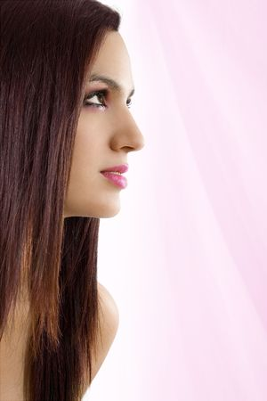 Stock image of beautiful woman over pink background Zdjęcie Seryjne