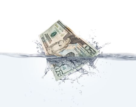 Stock image of Twenty dollar bill splashing into water over white  background, very detailed splash photo