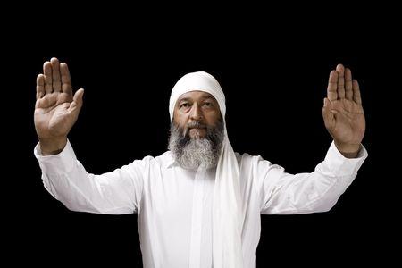 Stock image of Arab man praying over black background